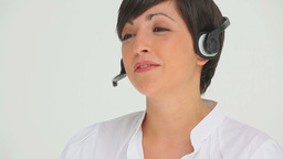 Businesswoman happily talking through a headset Footage
