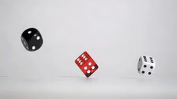 Three black red white dices in a super slow motion Footage