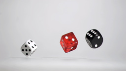 Three white red black dices in a super slow motion Footage