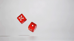 Two red dices in super slow motion turning Footage