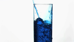 Thin trickle blue in super slow motion overflowing Stock Video Footage