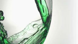 Close up, green trickle in a super slow motion spl Footage