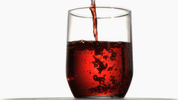 Red liquid in super slow motion flowing in a glass Stock Video Footage
