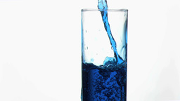 Blue liquid in super slow motion overflowing in a Stock Video Footage