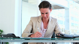 Businesswoman working at her office Footage