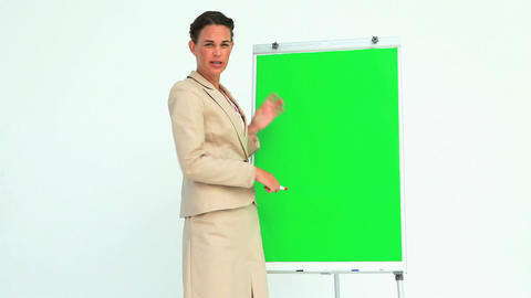 Woman giving a presentation with a board Stock Video Footage
