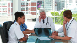 Doctors in a meeting examining a chest xray Stock Video Footage