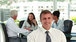 Portrait of a businessman with colleagues in meeti Footage