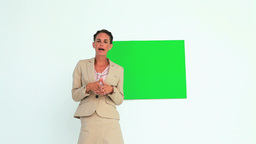 Woman talking in front of a board Footage