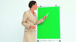 Businesswoman gesturing in front of a board Footage