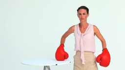 Businesswoman hitting a laptop with boxing gloves Footage