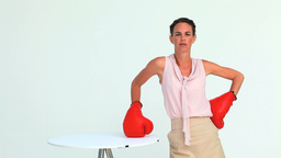 Businesswoman hitting a laptop with boxing gloves Stock Video Footage