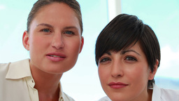 Two businesswomen working together Stock Video Footage