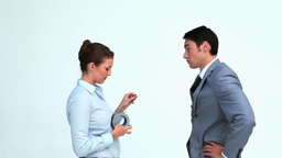 Woman putting adhesive tape on a businessmans mout Footage