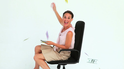 Businesswoman throwing banknotes in the air Footage