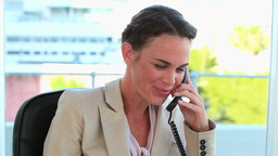 Businesswoman on the phone and looking at camera Stock Video Footage