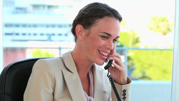 Welldressed woman phoning Stock Video Footage