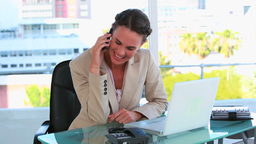 Businesswoman receiving a mobile phone call Footage
