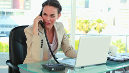 Businesswoman receiving a good news by phone Footage