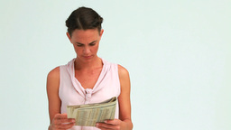 Businesswoman reading the news posing with a smile Footage