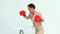 Woman in suit hitting a laptop with boxing gloves Footage