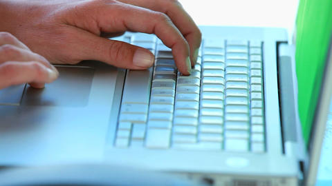 Close up on someoness hands typing on a laptop Stock Video Footage