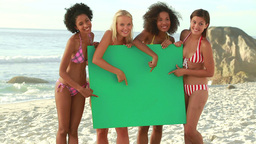 A group of women holding a green screen Stock Video Footage