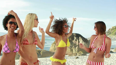 Four women wearing sunglasses partying in their bi Footage