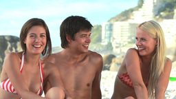 Three pals laughing at the beach Footage