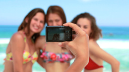 Women posing for a photo on the beach Stock Video Footage