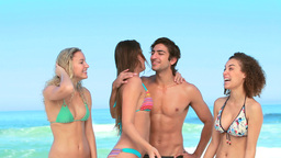 Three girls and a guy at the beach Footage