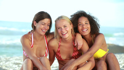 Three smiling girls embracing each other Stock Video Footage