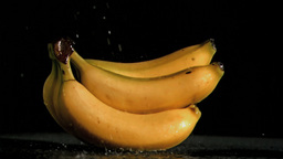 Delicious bananas in super slow motion being soake Footage
