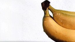 Bananas in super slow motion being soaked Stock Video Footage