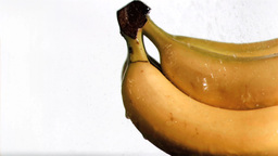 Bananas in super slow motion being soaked Footage