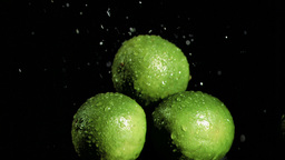 Limes in super slow motion being soaked Stock Video Footage