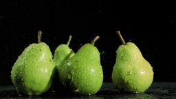 Tasty pears in super slow motion being soaked Footage