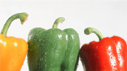 Colorful peppers in super slow motion being soaked Footage