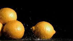 Delightful lemons in super slow motion receiving w Stock Video Footage