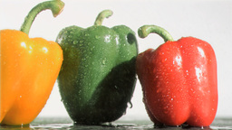 Peppers in super slow motion being soaked Footage