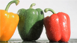 Peppers in super slow motion being soaked Stock Video Footage