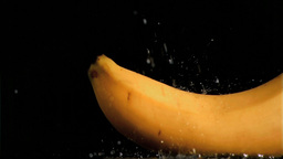 Delicious banana in super slow motion being soaked Footage