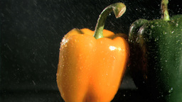Tasty peppers in super slow motion receiving water Footage