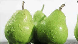 Water in super slow motion dripping on pears Stock Video Footage