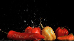 Spicy vegetables in super slow motion receiving dr Stock Video Footage