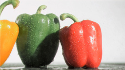 Delicious peppers in super slow motion receiving r Stock Video Footage