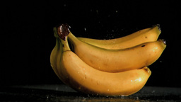 Bananas in super slow motion receiving raindrops Footage