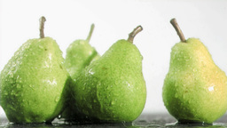 Pears in super slow motion being soaked Stock Video Footage