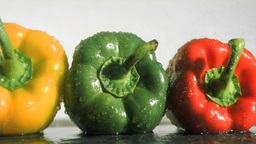 Colorful peppers in super slow motion receiving wa Footage