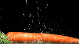 Carrot in super slow motion being soaked Footage
